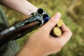 Autumn hunting season. Hunting. Outdoor sports. Woman hunter in the woods - detail of the rifle bein poster