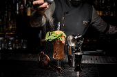 Bartender Pouring Sugar Into The Strong And Fresh Summer Shot Decorated With Fruit And Mint poster