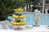 stock photo of swim meet  - A Table with drink in the swimming pool backyard - JPG