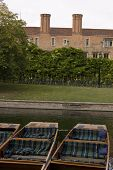 picture of magdalene  - A view across the banks of the River Cam in Cambridge across some moored punts - JPG