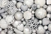 Silver and white christmas bauble decorations forming an abstract background. Traditional christmas  poster