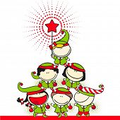 stock photo of elf  - Cute kids in costumes of elves created a christmas tree pyramid - JPG