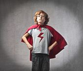 stock photo of mantle  - Child in superhero suit - JPG