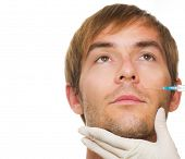 Man gets cosmetic injection of .Beauty Treatment