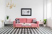 Pillows On Pink Sofa In Spacious Living Room Interior With Checkered Floor Plants And Poster. Real P poster