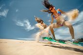 Kitesurfers party freestyle at dunes poster