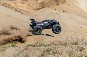 Big Radio Controlled Buggy Car Driving Fast And Slipping On Sand. Rc Toy Moving Fast On Cross-terrai poster
