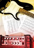 stock photo of stratocaster  - electric guitar and amplifier - JPG