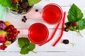 Refreshing Drink Compote Of Summer Berries In Glasses On A White Wooden Background. Top View. poster