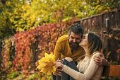 Love Relationship And Romance. Couple In Love In Autumn Park At Bench. Autumn Happy Couple Of Girl A poster