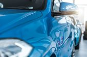 New Cars For Sale Showroom. Closeup Photo. Automotive Industry. Vehicles Dealer. poster
