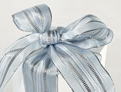 White Gift Box With Blue And Silver Bow