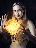 stock photo of sorcerer  - Portrait of dangerous woman witch with fire ball and dark make up - JPG
