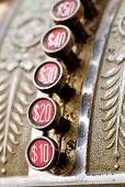 stock photo of cash register  - A detail of a vintage dirty cash register