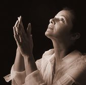 pic of piety  - Woman in prayer looking up to the Light sepia toned - JPG