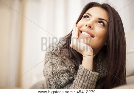 Closeup portrait of a Happy young beautiful woman relaxing at home poster