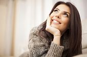 foto of comforter  - Closeup portrait of a Happy young beautiful woman relaxing at home - JPG