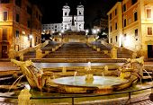 stock photo of fountains  - Spanish square Fountain of the old boat and Spanish steps by night Rome Italy - JPG