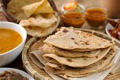 Chapati or Flat bread, roti canai, Indian food, made from wheat flour dough. Roti canai and curry.