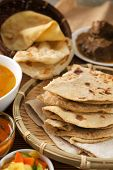 Chapati or Flat bread, Indian food, made from wheat flour dough. Roti canai and curry.