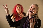 picture of gullible  - Embarrassed teen in pink hair with singing parent holding mp3 device - JPG
