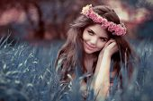 picture of fairyland  - Young beautiful woman resting on grass over fairy tale park Fairyland - JPG