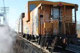 stock photo of caboose  - graffiti on a caboose with smoke freight