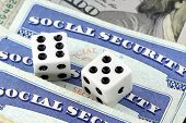 stock photo of citizenship  - White Dice Laying on Social Security Card