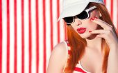 foto of funky  - Colorful summer portrait of an attractive young woman with sunglasses - JPG