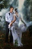 stock photo of skinny girl  - A young beautiful couple in a forest - JPG