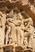 stock photo of kandariya mahadeva temple  - Apsara naked ladies sculpture on Kandariya Mahadeva Temple at Khajuraho in India Asia - JPG