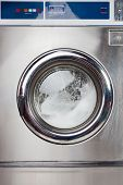 stock photo of laundromat  - Closeup of automatic washing machine in laundromat - JPG
