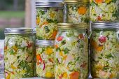 stock photo of leek  - home made cultured or fermented vegetables in glass jars - JPG
