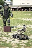 stock photo of landmines  - Bomb Squad specialiste and vehicle equipped with a remote - JPG