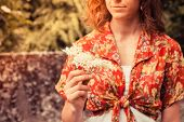 pic of elderflower  - A young woman is holding a bunch of elderflowers she has been picking - JPG