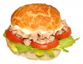stock photo of tomato sandwich  - Single tuna fish sandwich roll with lettuce and tomato - JPG