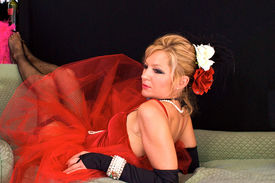stock photo of streetwalkers  - Beautiful blonde laying on sofa - JPG