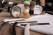 stock photo of barber razor  - hairdressing equipment like razor and  brush and mousse and  towel  in  professional  hairdressing salon - JPG