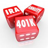 image of retirement  - 401K IRA and Annuity words on three red dice to illustrate risk and chance in savings for retirement with interest bearing accounts - JPG