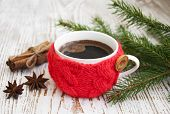 pic of christmas spices  - Christmas setting with knitted mug of coffee on a rustic wooden background - JPG