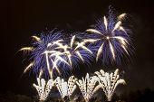 stock photo of pendulum  - The explosion of beautifully colored fireworks with Prague pendulum - JPG