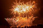 stock photo of pendulum  - The explosion of beautifully white fireworks with Prague Pendulum - JPG