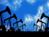 stock photo of nonrenewable  - Oil Wells Showing Extracting Oilwell And Refineries - JPG