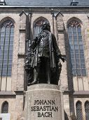 foto of leipzig  - The Neues Bach Denkmal meaning new Bach monument stands since 1908 in front of the St Thomas Kirche church where Johann Sebastian Bach is buried in Leipzig Germany - JPG