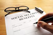 stock photo of social-security  - Social security benefits form showing financial concept in office - JPG