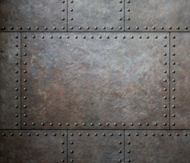 stock photo of ironclad  - metal texture with rivets as steam punk background - JPG