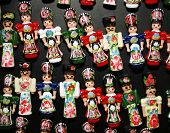 stock photo of dress-making  - Traditional handmade toys puppets dolls in symbolic artistic dress - JPG