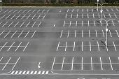 stock photo of tree lined street  - Vacant parking lot  - JPG