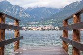 image of dock a lake  - Beautiful view of boat dock on Como lake in Italy - JPG
