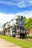 picture of locomotive  - Old rustic steam locomotive on station platform - JPG